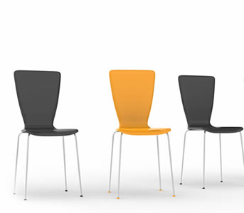 one yellow chair and two black chairs